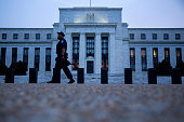 A Federal Reserve police officer walks past the Marriner S Eccles Federal Reserve building in Washington DC US on Wednesday Sept 2 2015 Bill Gross...