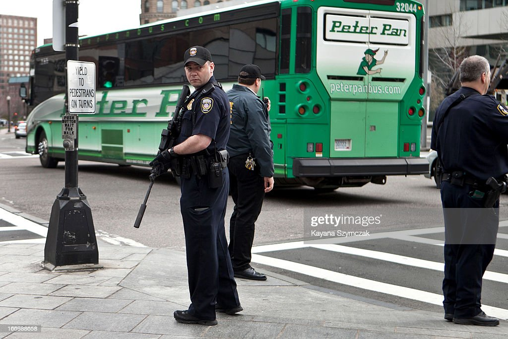 Federal Reserve Police officers patrol outside South Station on April 19, 2013 in Boston, Massachusetts. South Station was shut down and heavily guarded with police in response to the early morning shootings in Cambridge and Watertown, Massachusetts. After a car chase and shoot out with police, one suspect in the Boston Marathon bombing, Tamerlan Tsarnaev, 26, was shot and killed by police early morning April 19, and a manhunt is underway for his brother and second suspect, 19-year-old suspect Dzhokhar A. Tsarnaev. The two men, reportedly of Chechen origin, are suspects in the bombings at the Boston Marathon on April 15, that killed three people and wounded at least 170.