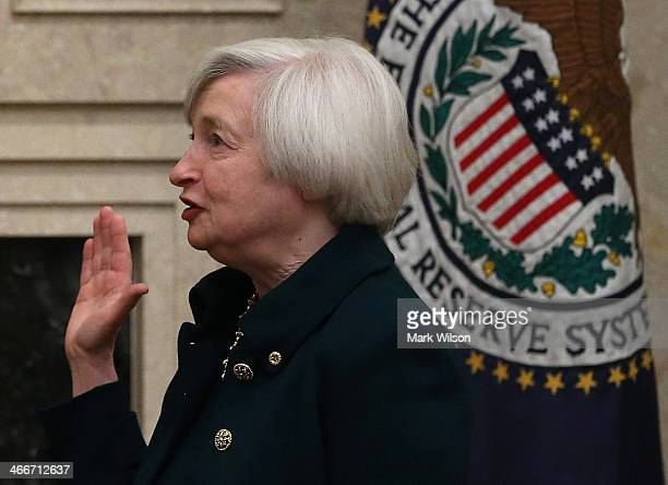 Federal Reserve Vice Chairman Janet Yellen is sworn as Federal Reserve Chairman at the Federal Reserve Building on February 3 2013 in Washington DC...