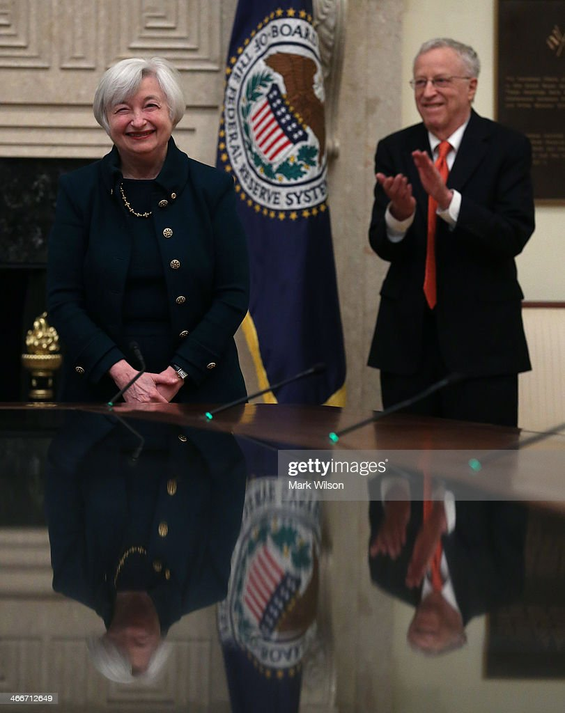 Federal Reserve Vice Chairman Janet Yellen (L) looks on after being sworn in as Federal Reserve Chairman as her husband George Akerlof looks on at the Federal Reserve Building on February 3, 2013 in Washington, DC. Chairman Yellen is replacing Ben Bernanke as Federal Reserve Chairman.