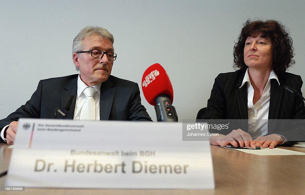 Federal state attorney Herbert Diemer (L) and state attorney Anette Greger address the media during a press conference at the Oberlandesgericht Muenchen state court building on the first day of the NSU neo-Nazi murder trial on May 6, 2013 in Munich, Germany. The main defendant, Beate Zschaepe, is on trial for her role in assisting Uwe Boehnhardt and Uwe Mundlos in the murder of nine immigrants and one policewoman across Germany between 2000 and 2007. Four other co-defendants, including Ralf Wohlleben, Holder G., Carsten S. and Andre E., are accused of assisting the trio. Zschaepe, Mundlos and Boehnhardt lived together for years undetected by police and called themselves the National Socialist Underground, or NSU. The case only came to light after Mundlos and Boehnhardt committed suicide when the two were cornered by police following a bank robbery in 2011.