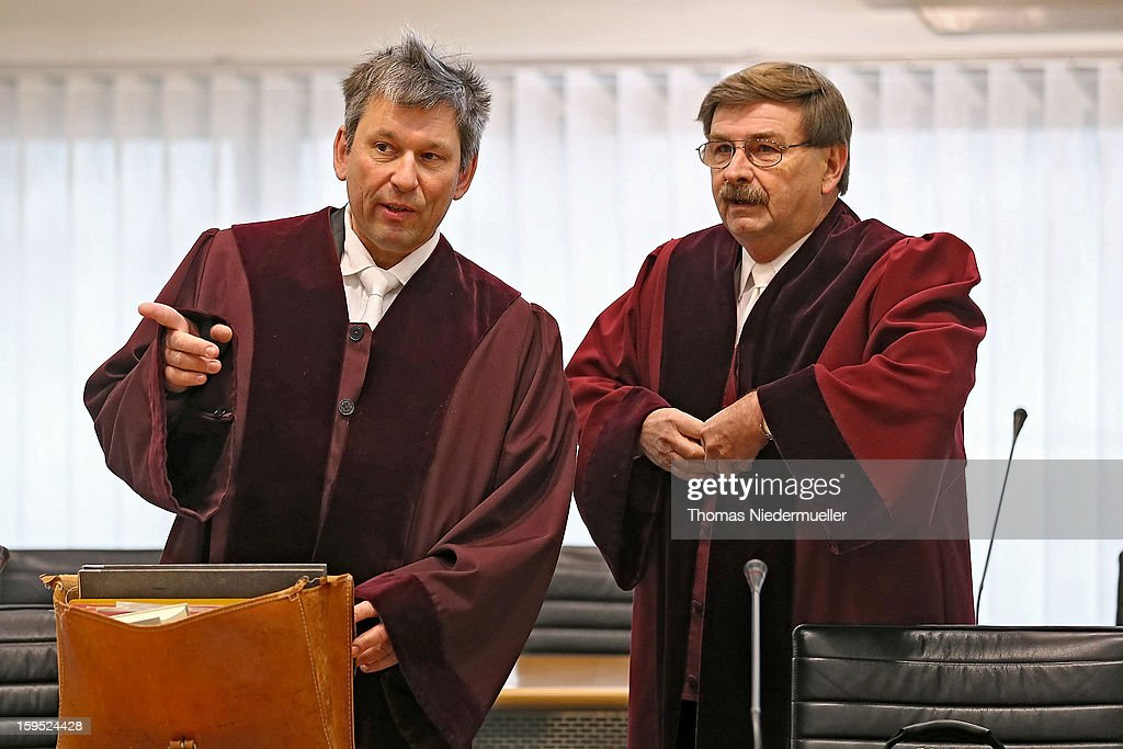 Federal State lawyers Wolfgang Siegmund (L) and Rolf Hannich (R) attend the trial of accused Russian spies with the aliases Andreas and Heidrun Anschlag in court on the first day of the trial on January 15, 2013 in Stuttgart, Germany. The couple, with the aliases Andreas and Heidrun Anschlag, came to Germany in 1988, reportedly as KGB spies, and continued operating for the modern Russian intelligence service while maintaining a front as immigrants from South America until their arrest in late 2011 by German police. Among the couple's biggest coups was recruiting Dutch Foreign Ministry worker Raymond Valentino Poeteray, who sold them top secret NATO documents. The couple also had a daughter while living in Germany who is now in her early 20's and reportedly knew nothing of her parents' true identity and espionage activities. German law enforcement authorities came onto the Anschlags' trail following the arrests last year of 10 Russian spies in the United States.