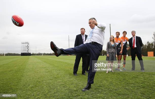 Federal Treasurer Joe Hockey kicks an AFL ball during the official opening of the Learning Life Centre at Sydney Olympic Park Sports Centre on...