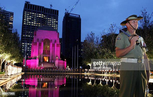 Federation Guard Commander Captain Mark Cole stand to attention during the ANZAC Memorial 75th Anniversary Ceremony on November 24 2009 in Sydney...