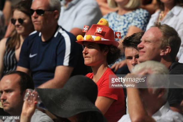 Federer fan watches Roger Federer of Switzerland in action against Grigor Dimitrov of Bulgaria on day seven of the 2017 Wimbledon Championships at...