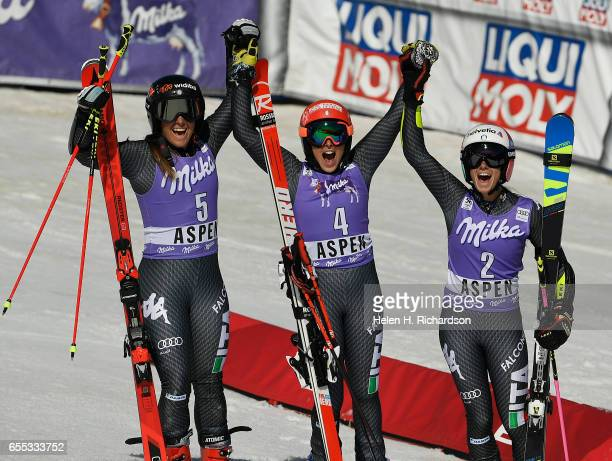 Federica Brignone #4 middle from Italy celebrates her victory in the World Cup ladies giant slalom along with her teammates Sofia Goggia #5 left who...