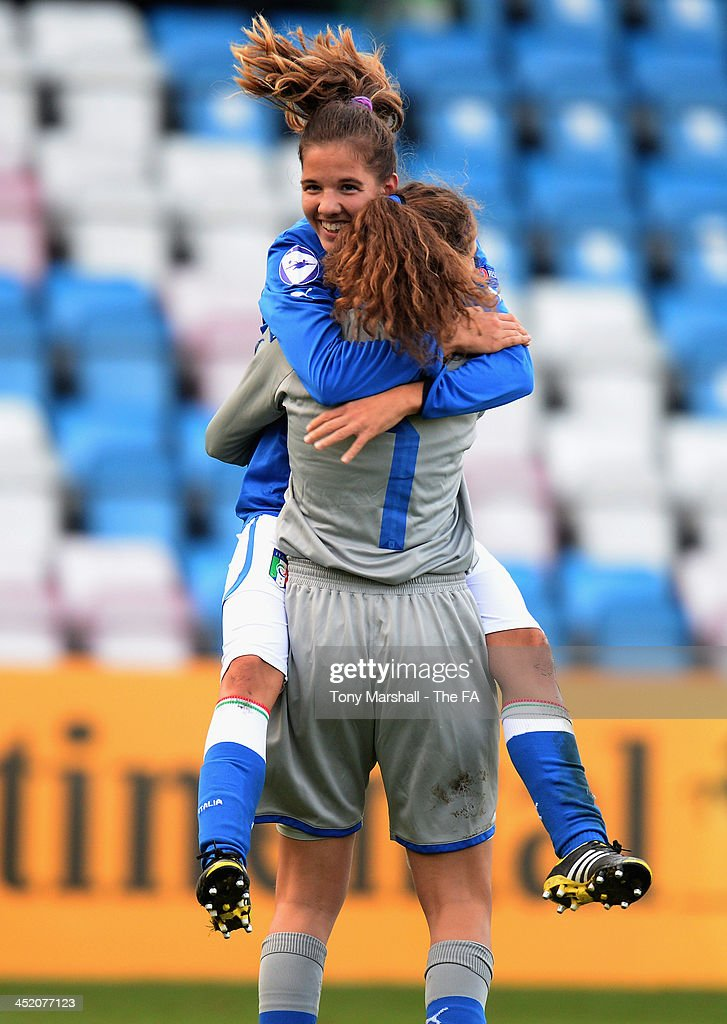 Federica Cavicchia of Italy (left), scorer of the only goal of the match celebrates with Francesca Durante at the final whistle the UEFA Womens U17 Championship Finals match between England and Italy at the AFC Telford New Bucks Head Stadium on November 26, 2013 in Telford, England.