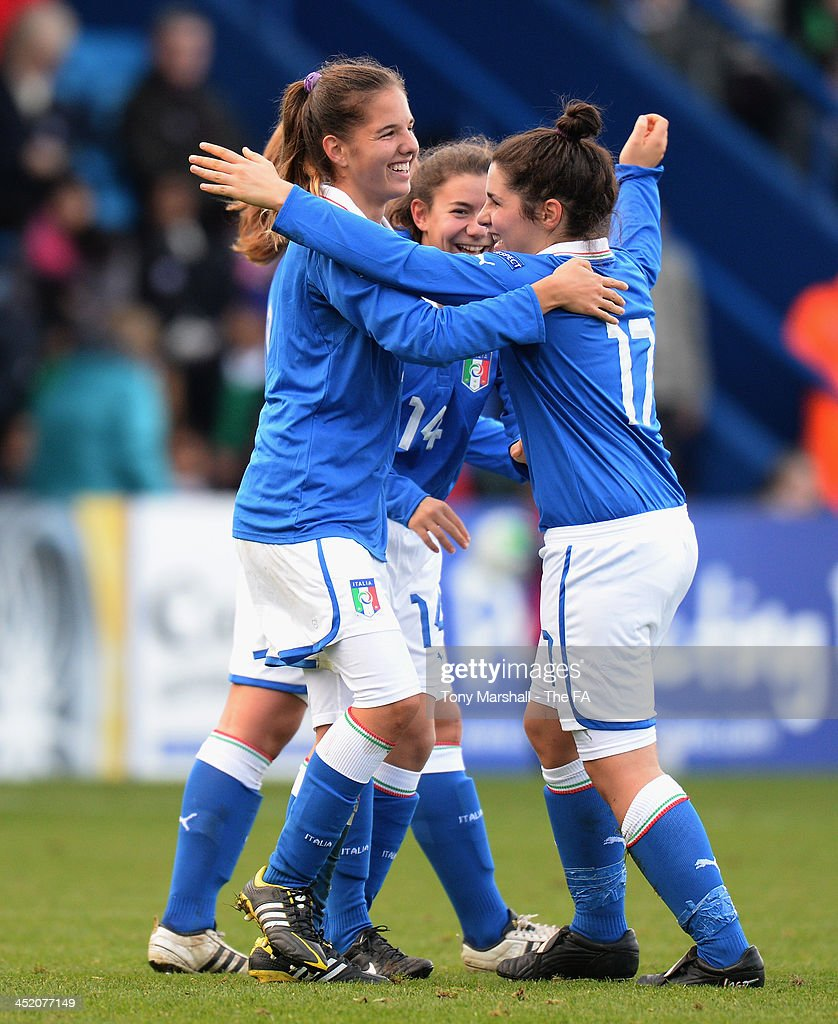 Federica Cavicchia of Italy (left), scorer of the only goal of the match celebrates with Marta Mascarello during the UEFA Womens U17 Championship Finals match between England and Italy at the AFC Telford New Bucks Head Stadium on November 26, 2013 in Telford, England.
