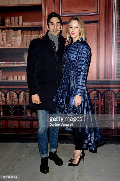 Federica Pellegrini and Filippo Magnini attend the Moncler show as a part of Milan Fashion Week Menswear Autumn/Winter 2014 on January 12 2014 in...