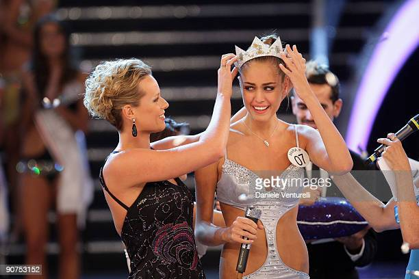 Federica Pellegrini and Newly elected 18yearold Maria Perrusi is crowned with the title of Miss Italy 2009 during the final of the beauty contest on...