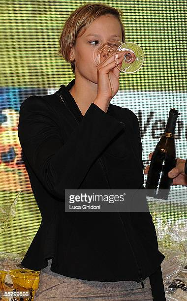 Federica Pellegrini drinks white wine at the Vinitaly on April 4 2009 in Verona Italy Vinitaly the international wine and spirit exhibition runs from...