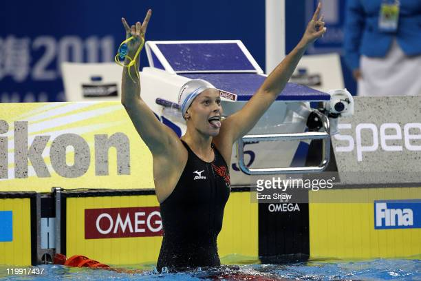 Federica Pellegrini of Italy celebrates winning the gold medal in the Women's 200m Freestyle Final during Day Twelve of the 14th FINA World...