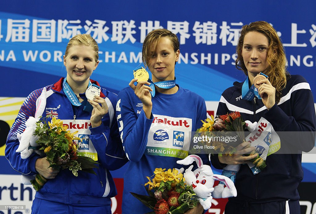 Federica Pellegrini of Italy poses with the gold medal and silver medalist Rebecca Adlington of Great Britain and bronze medalist Camille Muffat of...