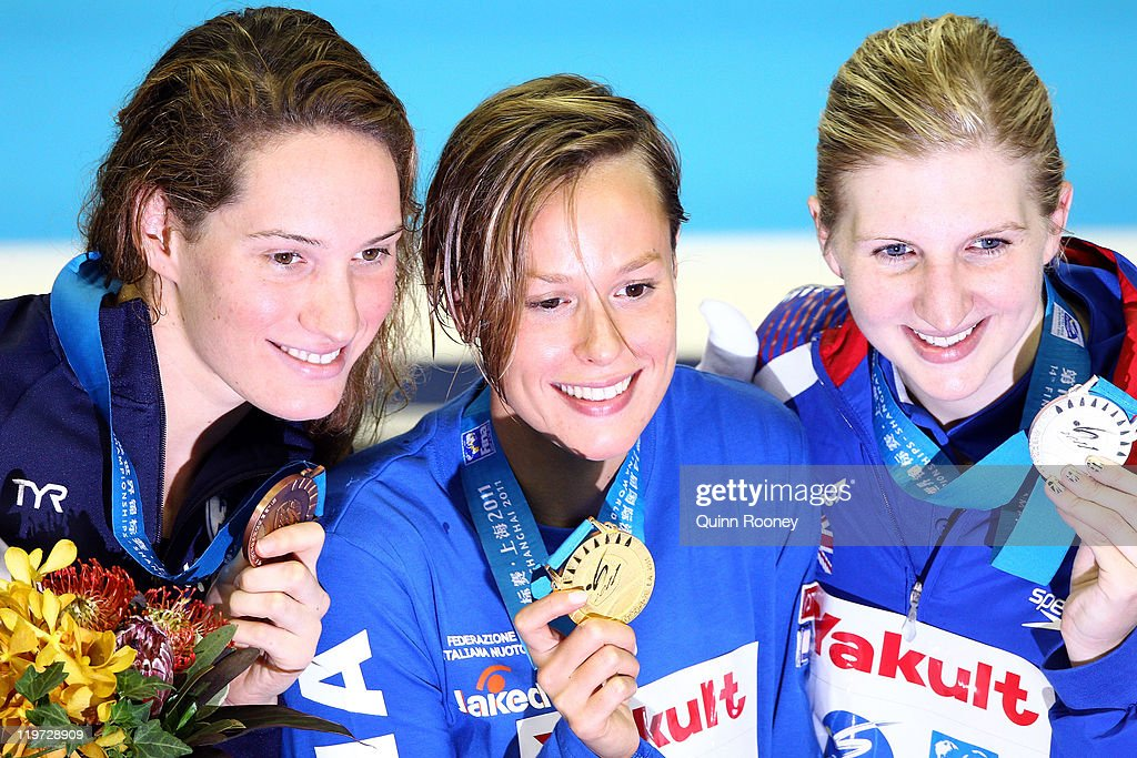 Federica Pellegrini (C) of Italy poses with the gold medal and silver medalist Rebecca Adlington (R) of Great Britain and bronze medalist Camille Muffat of France after the Women's 400m Freestyle Final during Day Nine of the 14th FINA World Championships at the Oriental Sports Center on July 24, 2011 in Shanghai, China.