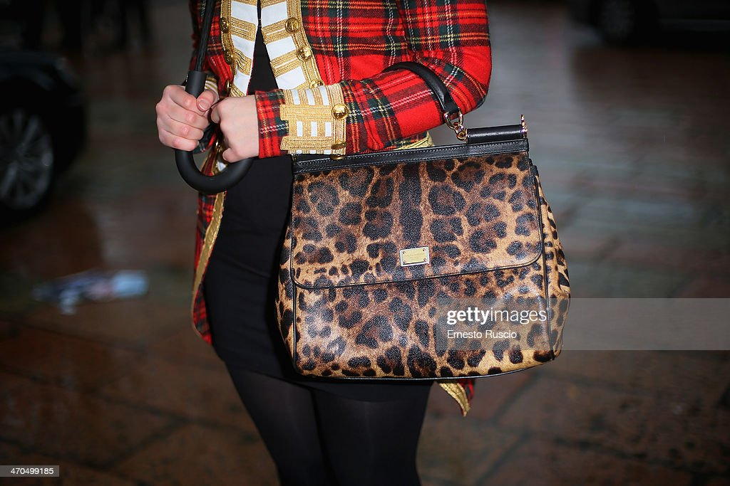 Federica Romani wears Ralph Lauren coat and Dolce & Gabbana bag on day 1 of Milan Fashion Week Womenswear Autumn/Winter 2014 on February 19, 2014 in Milan, Italy.