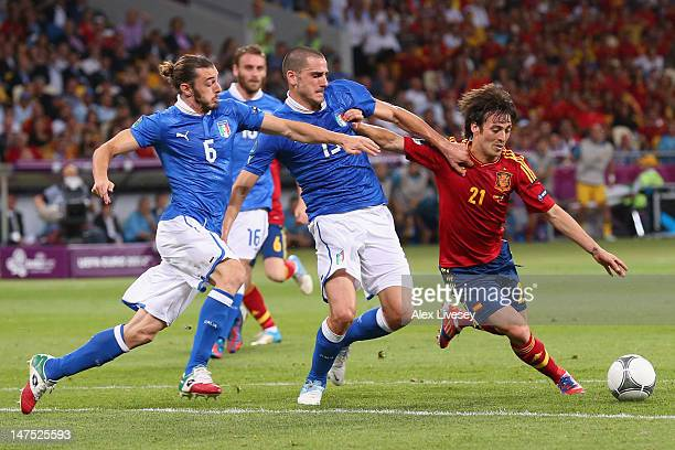 Federico Balzaretti and Leonardo Bonucci of Italy challenge David Silva of Spain during the UEFA EURO 2012 final match between Spain and Italy at the...