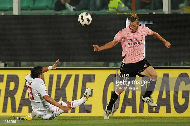 Federico Balzaretti of Palermo in action as Alessandro Nesta of Milan tackles during the Tim Cup between US Citta di Palermo and AC Milan at Stadio...