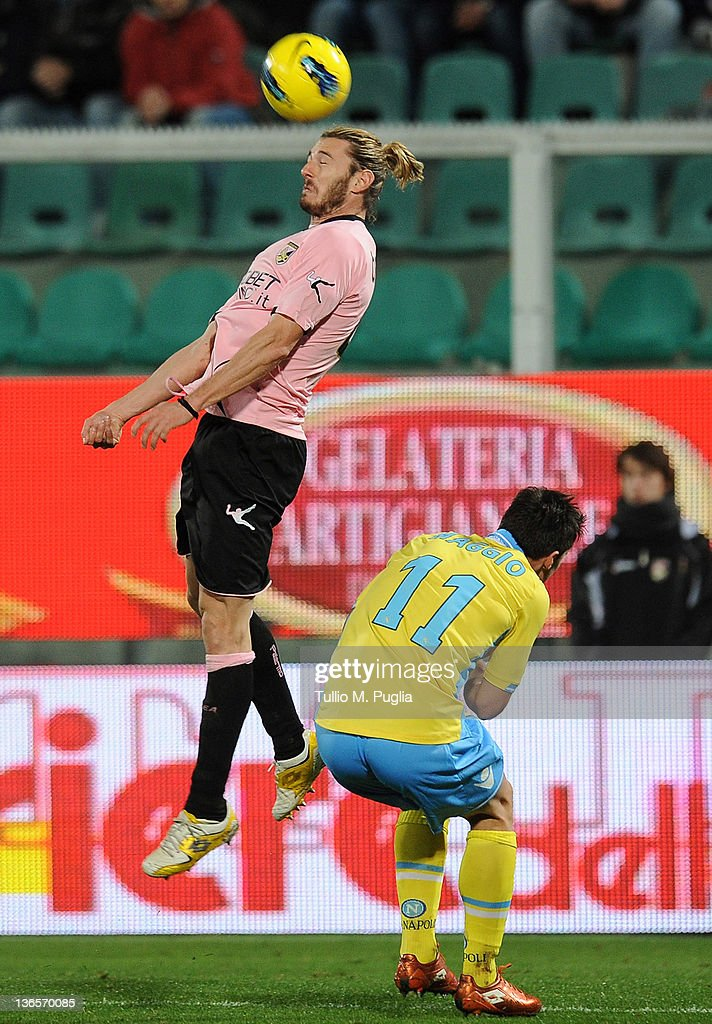 <a gi-track='captionPersonalityLinkClicked' href=/galleries/search?phrase=Federico+Balzaretti&family=editorial&specificpeople=686070 ng-click='$event.stopPropagation()'>Federico Balzaretti</a> (L) of Palermo jumps for a header as <a gi-track='captionPersonalityLinkClicked' href=/galleries/search?phrase=Christian+Maggio&family=editorial&specificpeople=2131601 ng-click='$event.stopPropagation()'>Christian Maggio</a> of Napoli reacts during the Serie A match between US Citta di Palermo and SSC Napoli at Stadio Renzo Barbera on January 8, 2012 in Palermo, Italy.