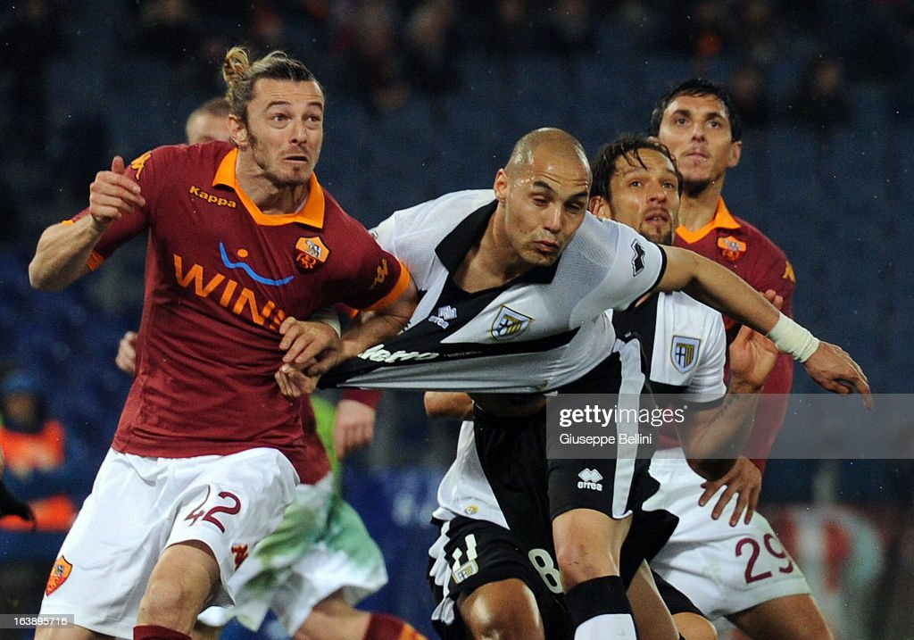 Federico Balzaretti of Roma and Yohan Benalouane of Parma in action during the Serie A match between AS Roma and Parma FC at Stadio Olimpico on March 17, 2013 in Rome, Italy.