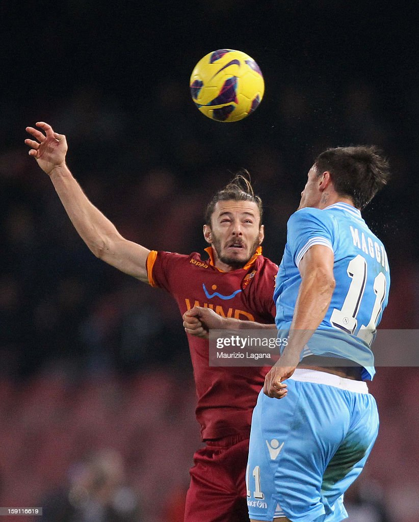 Federico Balzaretti (L) of Roma competes for the ball in air with Christian Maggio of Napoli during the Serie A match between SSC Napoli and AS Roma at Stadio San Paolo on January 6, 2013 in Naples, Italy.