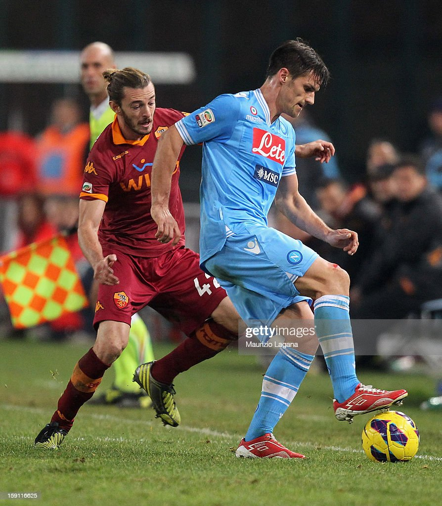 Federico Balzaretti (L) of Roma competes for the ball with Christian Maggio of Napoli during the Serie A match between SSC Napoli and AS Roma at Stadio San Paolo on January 6, 2013 in Naples, Italy.