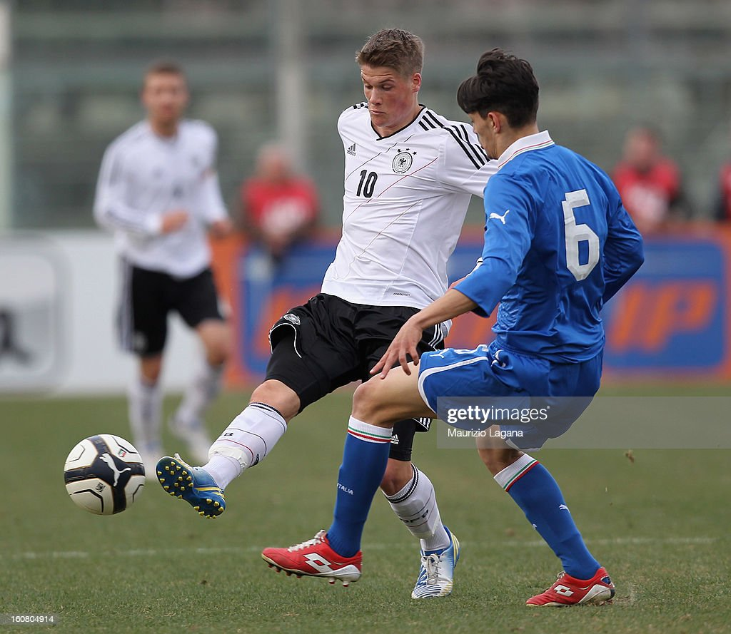 Federico Barba (R) of Italy competes for the ball with Johannes Wurtz of Germany during U20 International Friendly match between Italy and Germany at Stadio Cosimo Puttilli on February 6, 2013 in Barletta, Italy.