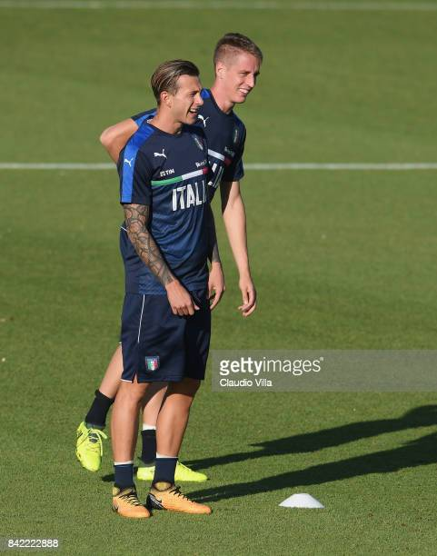 Federico Bernardeschi and Andrea Conti of Italy look on during the training session at Italy club's training ground at Coverciano on September 03...