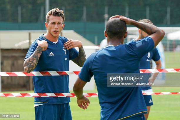 Federico Bernardeschi and Douglas Costa of Juventus during a training session on August 9 2017 in Vinovo Italy