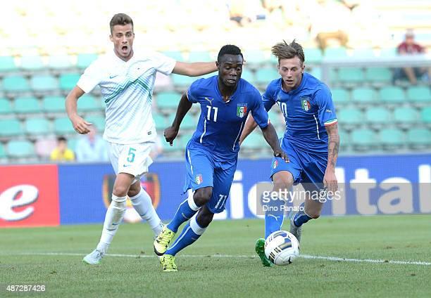 Federico Bernardeschi and Kingley Boateng of Italy U21 compete with Denis Sme of Slovenia U21 during the 2017 UEFA European U21 Championships...