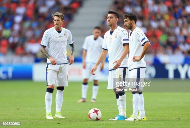 Federico Bernardeschi Lorenzo Pellegrini and Danilo Cataldi of Italy stand at a free kick during the UEFA European Under21 Championship Group C match...