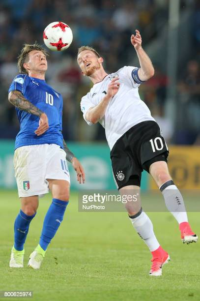 Federico Bernardeschi Maximilian Arnold during the UEFA U21 European Championship Group C football match Italy v Germany in Krakow Poland on June 24...