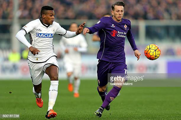 Federico Bernardeschi of ACF Fiorentina battles for the ball with Edenilson of Udinese Calcio during the Serie A match between ACF Fiorentina and...
