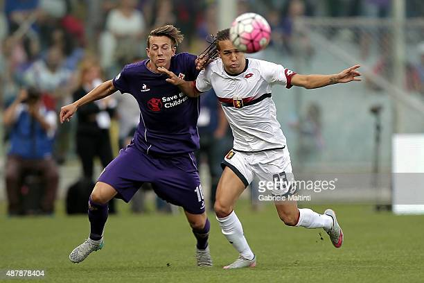 Federico Bernardeschi of ACF Fiorentina battles for the ball with Diego Laxalt of Genoa CFC during the Serie A match between ACF Fiorentina and Genoa...