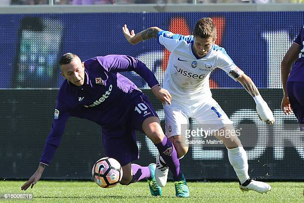 Federico Bernardeschi of ACF Fiorentina battles for the ball with Alejandro Gomez of Atalanta BC during the Serie A match between ACF Fiorentina and...