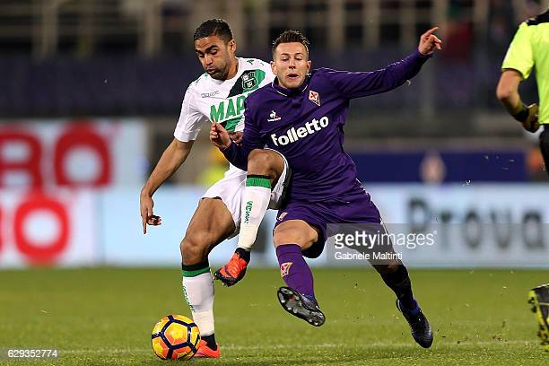 Federico Bernardeschi of ACF Fiorentina battles for the ball with Gregoire Defrel of US Sassuolo during the Serie A match between ACF Fiorentina and...