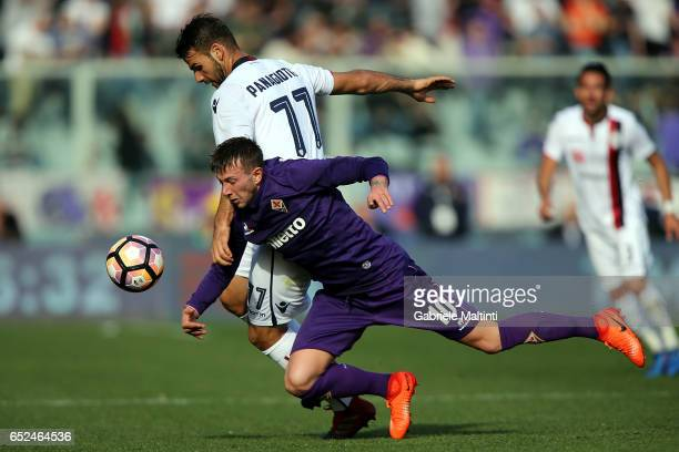 Federico Bernardeschi of ACF Fiorentina battles for the ball with Panagiotis Tachtsidis of Cagliari Calcio during the Serie A match between ACF...