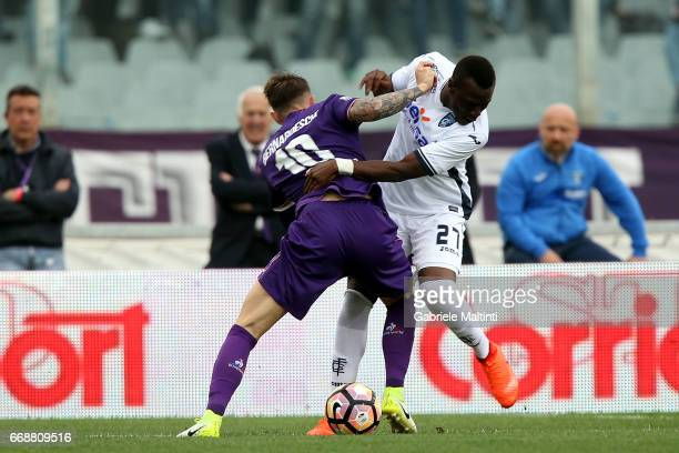 Federico Bernardeschi of ACF Fiorentina battles for the ball with Mama Babe Thiam of Empoli FC during the Serie A match between ACF Fiorentina and...