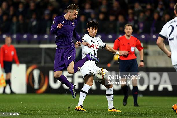 Federico Bernardeschi of ACF Fiorentina battles for the ball with Son HeungMin of Tottenham Hotspur during the UEFA Europa League Round of 32 first...