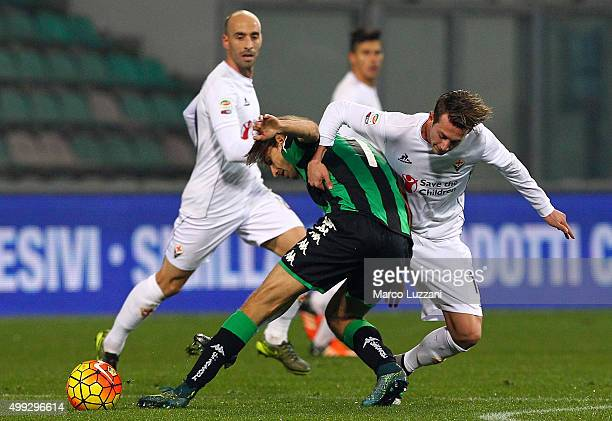 Federico Bernardeschi of ACF Fiorentina competes for the ball with Simone Missiroli of US Sassuolo Calcio during the Serie A match between US...