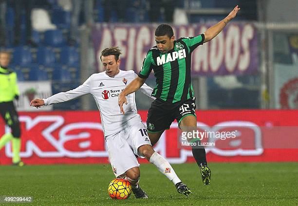 Federico Bernardeschi of ACF Fiorentina competes for the ball with Gregoire Defrel of US Sassuolo Calcio during the Serie A match between US Sassuolo...