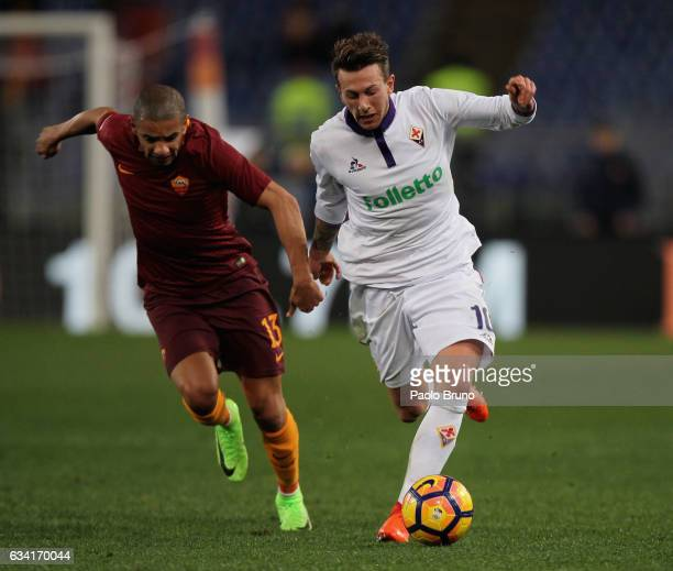 Federico Bernardeschi of ACF Fiorentina competes for the ball with Bruno Peres of AS Roma during the Serie A match between AS Roma and ACF Fiorentina...