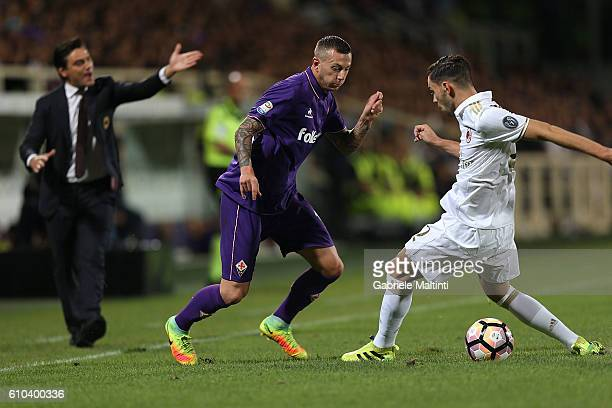 Federico Bernardeschi of ACF Fiorentina fights for the ball with Andrea De Ciglio of AC Milan during the Serie A match between ACF Fiorentina and AC...