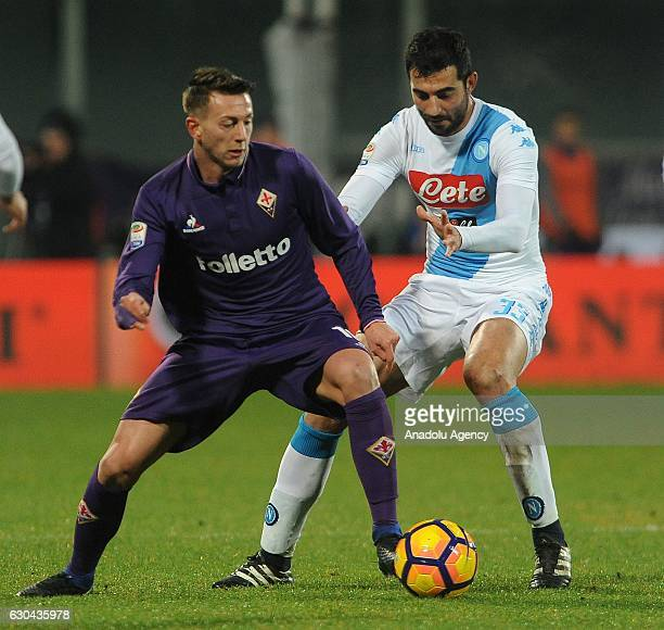 Federico Bernardeschi of Acf Fiorentina in action against Raul Albiol during the Italian Serie A soccer match between ACF Fiorentina and SSC Napoli...