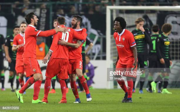 Federico Bernardeschi of ACF Fiorentina is congratulated by his teammates after scoring the opening goal during the UEFA Europa League Round of 32...