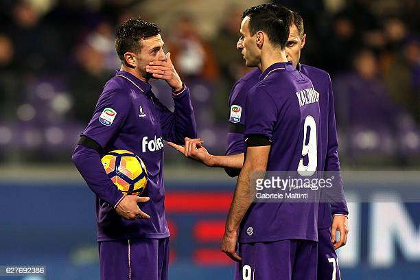 Federico Bernardeschi of ACF Fiorentina talks with Nikola Kalinic and Josip Ilicic before kicking the penalty during the Serie A match between ACF...