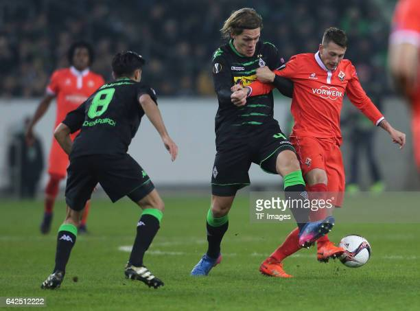 Federico Bernardeschi of Fiorentina and Jannik Vestergaard of Moenchengladbach battle for the ball during the UEFA Europa League Round of 32 first...