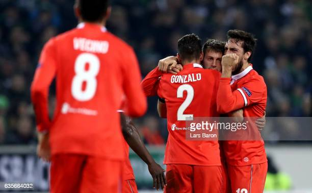 Federico Bernardeschi of Fiorentina celebrates with team mates after scoring his teams first goal during the UEFA Europa League Round of 32 first leg...