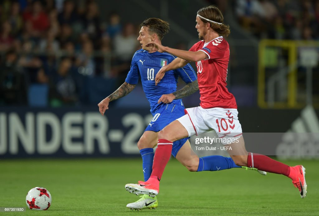 Federico Bernardeschi of Italy and Lucas Qvistorff Andersen of Denmark battle for possession during the UEFA European Under-21 Championship Group C match between Denmark and Italy at Krakow Stadium on June 18, 2017 in Krakow, Poland.