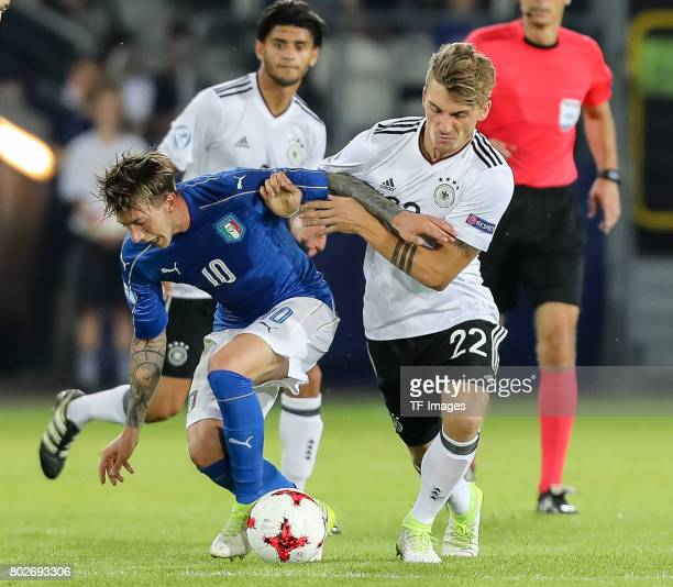 Federico Bernardeschi of Italy and Maximilian Philipp of Germany battle for the ball during the UEFA U21 championship match between Italy and Germany...