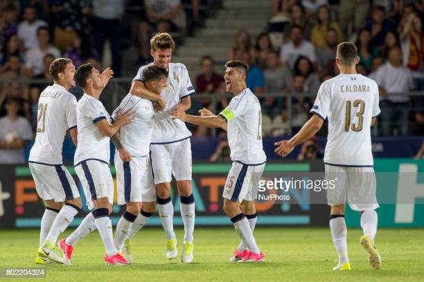 Federico Bernardeschi of Italy celebrates with his teammate during the UEFA European Under21 Championship SemiFinal match between Spain and Italy at...